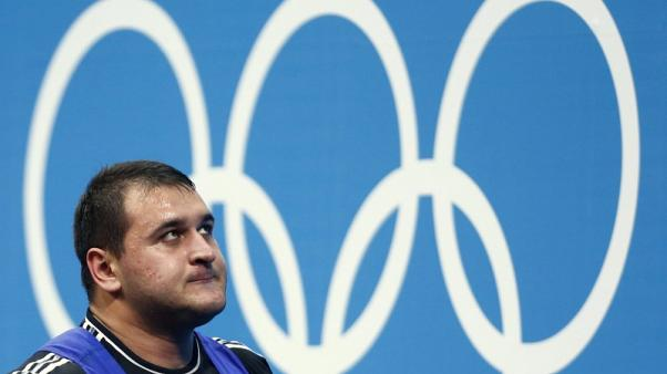 Russia's Ruslan Albegov reacts after failing a lift attempt during the men's +105kg Group A clean and jerk weightlifting competition at the ExCel venue during the London 2012 Olympic Games August 7, 2012.   REUTERS/Dominic Ebenbichler