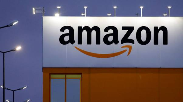 FILE PHOTO - The logo of Amazon is seen at the company logistics center in Lauwin-Planque, northern France, February 20, 2017. REUTERS/Pascal Rossignol