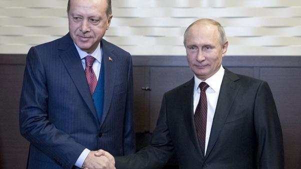 Russia's Putin - our work with Turkey, Iran is producing results in Syria
