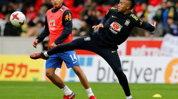 FILE PHOTO - Soccer Football - International Friendly - Brazil vs Japan - Stade Pierre-Mauroy, Lille, France - November 10, 2017   Brazil's Gabriel Jesus and Thiago Silva warm up before the match. REUTERS/Pascal Rossignol