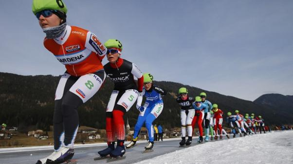 FILE PHOTO - Athletes compete during a mass start event in the Carinthian village of Techendorf January 29, 2015. REUTERS/Leonhard Foeger
