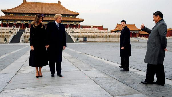 FILE PHOTO: U.S. President Donald Trump and U.S. first lady Melania visit the Forbidden City with China's President Xi Jinping in Beijing, China, November 8, 2017. REUTERS/Jonathan Ernst/File Photo