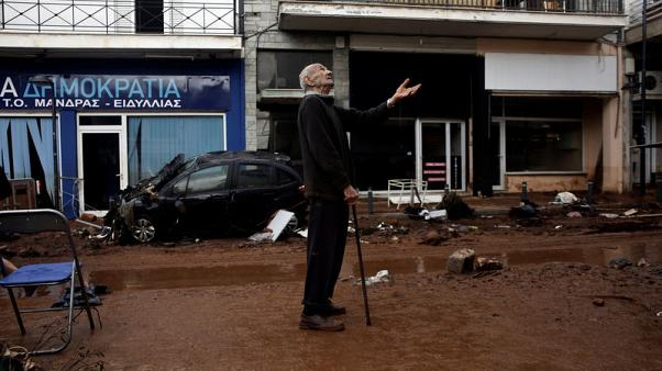 A local gestures as he stands next to a muddy street, following flash floods which hit areas west of Athens on November 15 killing at least 15 people, in Mandra, Greece, November 16, 2017. REUTERS/Alkis Konstantinidis