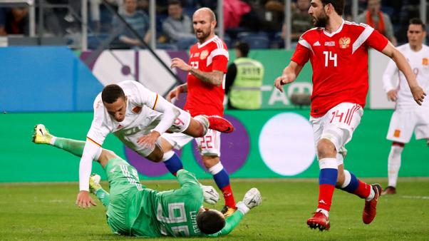Soccer Football - International Friendly - Russia vs Spain - Krestovsky Stadium, Saint Petersburg, Russia - November 14, 2017   Spain's Rodrigo collides with Russia's Andrey Lunev     REUTERS/Maxim Shemetov