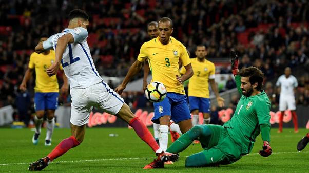 Soccer Football - International Friendly - England vs Brazil - Wembley Stadium, London, Britain - November 14, 2017   Brazil's Alisson and Miranda in action with England's Dominic Solanke              REUTERS/Dylan Martinez