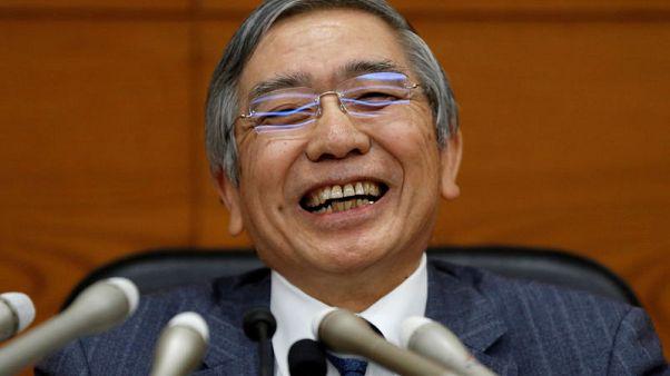 Bank of Japan (BOJ) Governor Haruhiko Kuroda laughs during a news conference at the BOJ headquarters in Tokyo, Japan, October 31, 2017. REUTERS/Toru Hanai