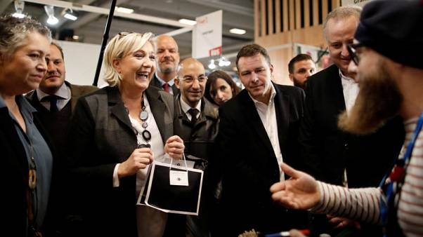 "Marine Le Pen, member of parliament and head of France's far-right National Front (FN) political party, laughs as she visits the ""Made In France"" fair in Paris, France, November 12, 2017. REUTERS/Benoit Tessier"