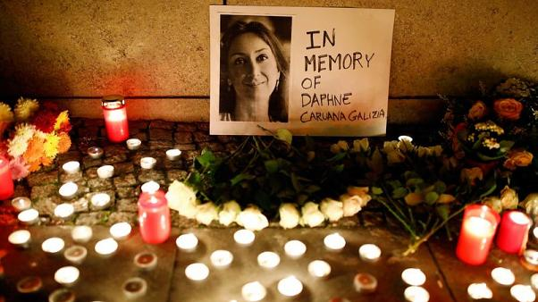 Candles burn to commemorate the killed investigative journalist Daphne Caruana Galizia in Berlin, Germany, October 20, 2017. REUTERS/Axel Schmidt