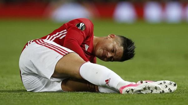 FILE PHOTO - Britain Football Soccer - Manchester United v RSC Anderlecht - UEFA Europa League Quarter Final Second Leg - Old Trafford, Manchester, England - 20/4/17 Manchester United's Marcos Rojo sustains an injury Reuters / Andrew Yates Livepic/Files