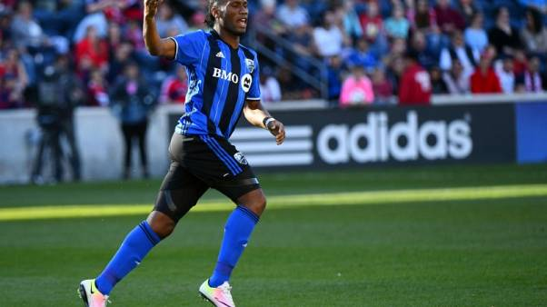 FILE PHOTO - Apr 16, 2016; Chicago, IL, USA;  Montreal Impact forward Didier Drogba (11) reacts after scoring a goal against the Chicago Fire during the second half at Toyota Park. Mandatory Credit: Mike DiNovo-USA TODAY Sports  / Reuters