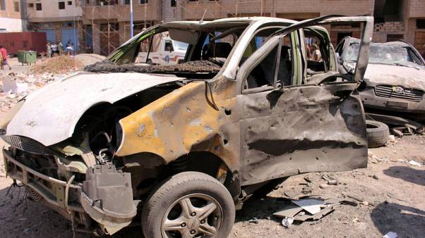 Damaged cars are seen near the site of a suicide car bomb attack outside a police forces camp in Aden, Yemen, November 14, 2017. REUTERS/Fawaz Salman