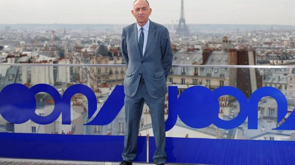 """Jean-Marc Janaillac, Chairman and Chief Executive Officer of Air France-KLM and Chairman of Air France, poses next to the logo of the new """"Joon"""" lower-cost airline during a news conference in Paris, France, September 25, 2017.   REUTERS/Charles Platiau"""