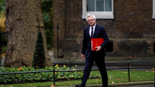 Britain pledges protection for bankers from EU migration curbs