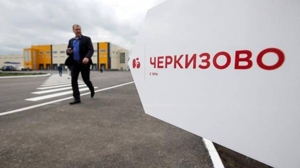 A man walks past a Russian meat company Cherkizovo sign at the Tambov Turkey facility, a joint venture between Cherkizovo and Spanish agricultural holding company Grupo Fuertes, outside Tambov, Russia May 30, 2017. REUTERS/Maxim Shemetov
