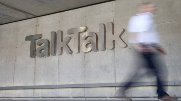 FILE PHOTO - A man passes a branded logo outside the Talktalk headquarters in London, Britain May 10, 2017. REUTERS/Neil Hall