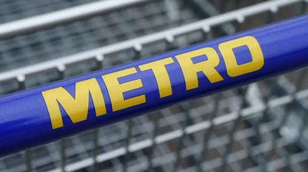 The logo of German retailer Metro is pictured on a shopping cart at a market in Langenzersdorf, Austria, March 30, 2016. REUTERS/Heinz-Peter Bader
