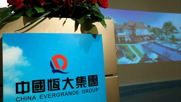 Evergrande to raise 60 billion yuan ahead of backdoor listing in China