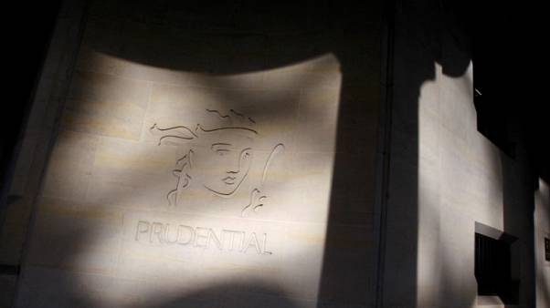 FILE PHOTO: Shadows are cast onto the logo of British life insurer Prudential on their building, in London October 21, 2008.   REUTERS/Stephen Hird/File Photo