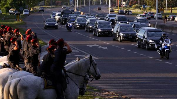 The funeral motorcade of the five Argentine citizens who were killed in the truck attack in New York on October 31 passes by as mounted policemen salute in Buenos Aires, Argentina November 6, 2017. REUTERS/Marcos Brindicci