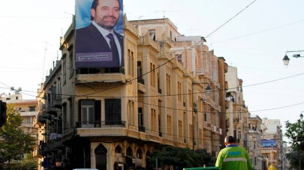 A poster depicting Lebanon's Prime Minister Saad al-Hariri, who has resigned from his post, hangs on a building in Tripoli, northern Lebanon, November 7, 2017. REUTERS/Omar Ibrahim