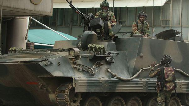 Zimbabwe's Mugabe resisting army pressure to quit - senior source