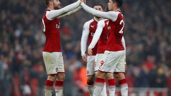 Soccer Football - Premier League - Arsenal vs Tottenham Hotspur - Emirates Stadium, London, Britain - November 18, 2017   Arsenal's Shkodran Mustafi and Arsenal's Granit Xhaka celebrate after the match   Action Images via Reuters/Paul Childs
