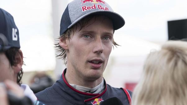 Oct 21, 2017; Austin, TX, USA; Toro Rosso driver Brendon Hartley (39) of New Zealand is interviewed after qualifying for the United States Grand Prix at Circuit of the Americas. Mandatory Credit: Jerome Miron-USA TODAY Sports