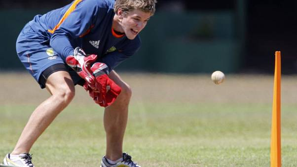 FILE PHOTO: Australia's wicket keeper Tim Paine catches a ball during a practice session before Saturday's Cricket World Cup match against Sri Lanka in Colombo March 2, 2011. REUTERS/Andrew Caballero-Reynolds
