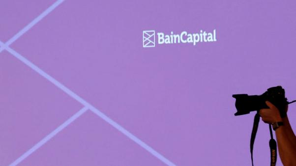 FILE PHOTO: The logo of Bain Capital is displayed on the screen during a news conference in Tokyo, Japan October 5, 2017. REUTERS/Kim Kyung-Hoon/File Photo