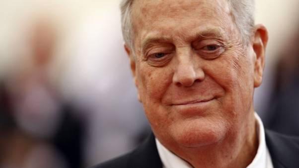 """FILE PHOTO - Businessman David Koch arrives at the Metropolitan Museum of Art Costume Institute Gala Benefit celebrating the opening of """"Charles James: Beyond Fashion"""" in Upper Manhattan, New York May 5, 2014.  REUTERS/Carlo Allegri"""