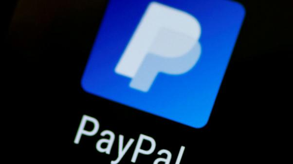 FILE PHOTO: The PayPal app logo seen on a mobile phone in this illustration photo October 16, 2017.   REUTERS/Thomas White/Illustration/File Photo