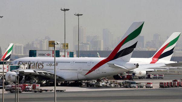 FILE PHOTO: Emirates Airlines aircraft are seen at Dubai International Airport, United Arab Emirates May 10, 2016. REUTERS/Ashraf Mohammad/File Photo