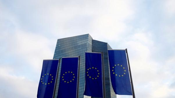 FILE PHOTO - European Union (EU) flags fly in front of the European Central Bank (ECB) headquarters in Frankfurt, Germany, December 3, 2015. REUTERS/Ralph Orlowski/File Photo