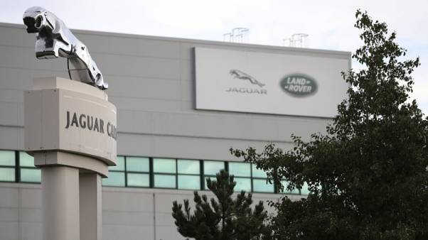 Signs are seen outside the Jaguar Land Rover plant at Halewood in Liverpool, northern England, September 12 , 2016. REUTERS/Phil Noble