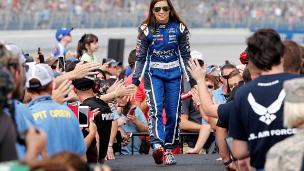 Race fans greet Danica Patrick as she is introduced on race day for NASCAR's Alabama 500 at Talladega Superspeedway in Lincoln, Alabama, U.S. October 15, 2017.  REUTERS/Jonathan Ernst