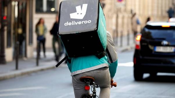FILE PHOTO: A cyclist rides a bicyle as he delivers food for Deliveroo, an example of the emergence of what is known as the 'gig economy', in Paris, France, April 7, 2017. REUTERS/Charles Platiau/File Photo