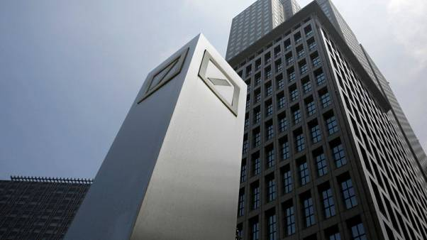 FILE PHOTO : Logos of Deutsche Bank AG are seen in Tokyo July 16, 2014. REUTERS/Toru Hanai/File Photo