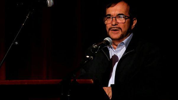 Despite setbacks, Colombian leader, ex-rebel boss still back peace pact