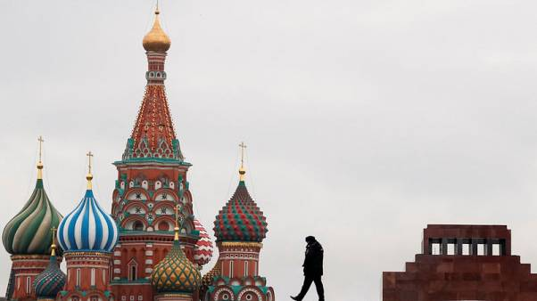 A police officer walks along the Red Square, with St. Basil's Cathedral and the Mausoleum of Soviet state founder Vladimir Lenin seen in the background, in Moscow, Russia November 5, 2017.  REUTERS/Grigory Dukor