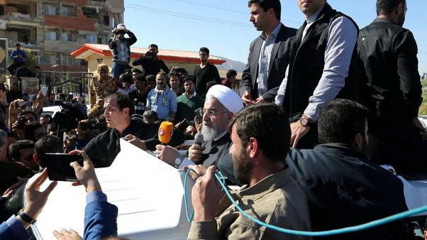 Iranian President Hassan Rouhani speaks as he visits Sarpol-e Zahab county in Kermanshah that was hit by a powerful earthquake, Iran November 14, 2017. President.ir/Handout via REUTERS