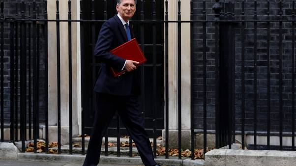 FILE PHOTO - Britain's Chancellor of the Exchequer Philip Hammond arrives at 10 Downing Street in London, October 30, 2017. REUTERS/Peter Nicholls