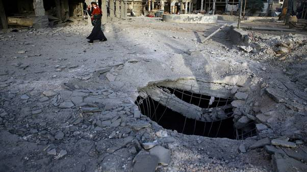 Syrian government bombing, rebel shells hit Damascus and suburbs