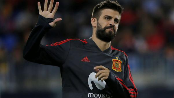 Pique booking gives Barca defensive headache against Valencia