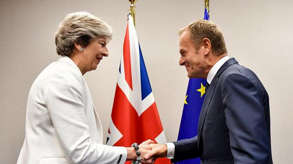 Britain's Prime Minister Theresa May shakes hands with European Council President Donald Tusk before a bilateral meeting at a European Union leaders summit in Brussels, Belgium October 20, 2017. REUTERS/Geert Vanden Wijngaert/Pool