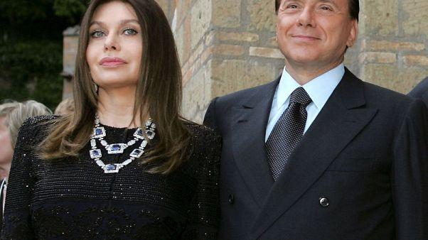 FILE PHOTO: Italy's Prime Minister Silvio Berlusconi and his wife Veronica Lario pose at Villa Madama in Rome, Italy June 4, 2004. REUTERS/Alessandro Bianchi/File Photo