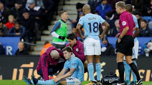 Soccer Football - Premier League - Leicester City vs Manchester City - King Power Stadium, Leicester, Britain - November 18, 2017   Manchester City's John Stones receives medical attention after sustaining an injury       REUTERS/Darren Staples