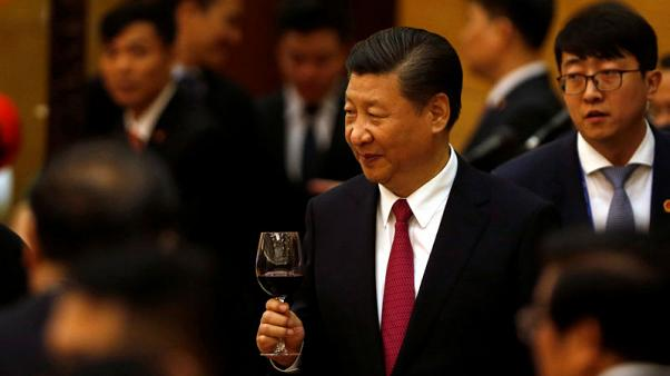 China's President Xi Jinping raises a toast at a State Banquet to welcome him in Hanoi, Vietnam November 12, 2017. REUTERS/Kham