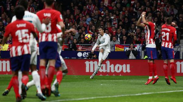 Real title hopes fade further after derby draw at Atletico