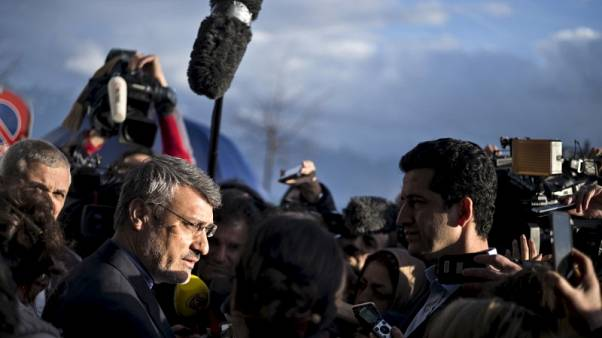 Hamid Baeedinejad (L), an Iranian official, speaks with press about negotiations on Iran's nuclear programme outside the Beau Rivage Palace Hotel in Lausanne March 31, 2015. REUTERS/Brendan Smialowski/Pool
