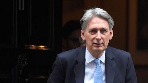 FILE PHOTO - Britain's Finance Secretary Philip Hammond leaves 11 Downing Street, London, Britain, November 15, 2017. REUTERS/Toby Melville